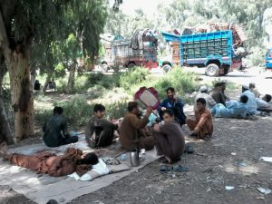 Afghan Refugees waiting outside the Voluntary Repatriation Centre: Photo by News Lens Pakistan/